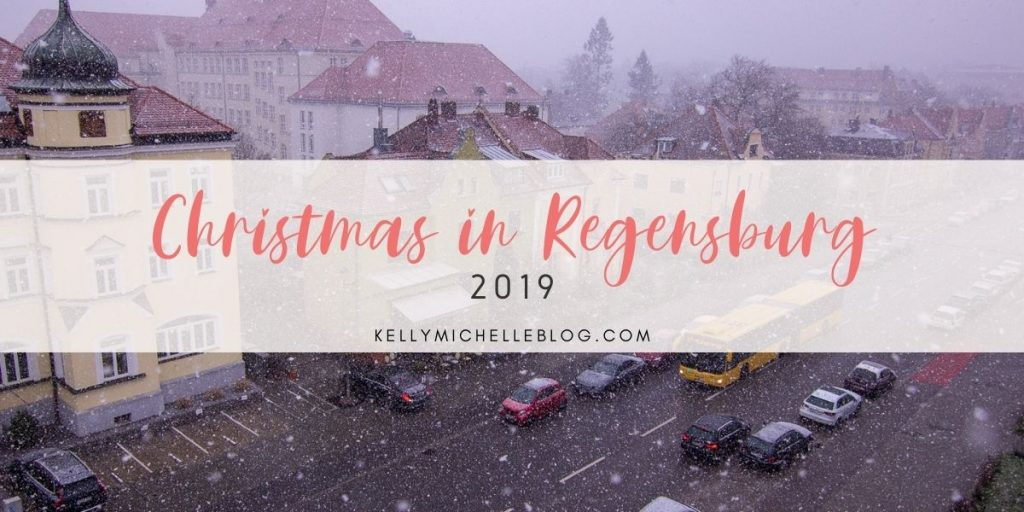 City scape with snow falling. Text overlay: Christmas in Regensburg 2019. kellymichelleblog.com