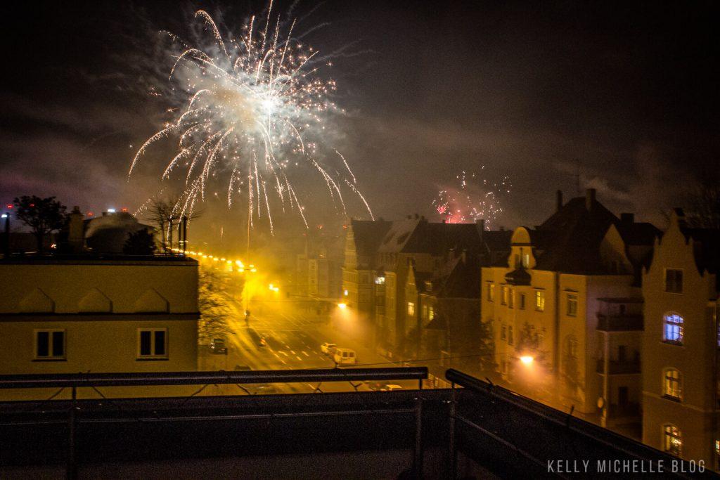 Firework going off over German buildings.