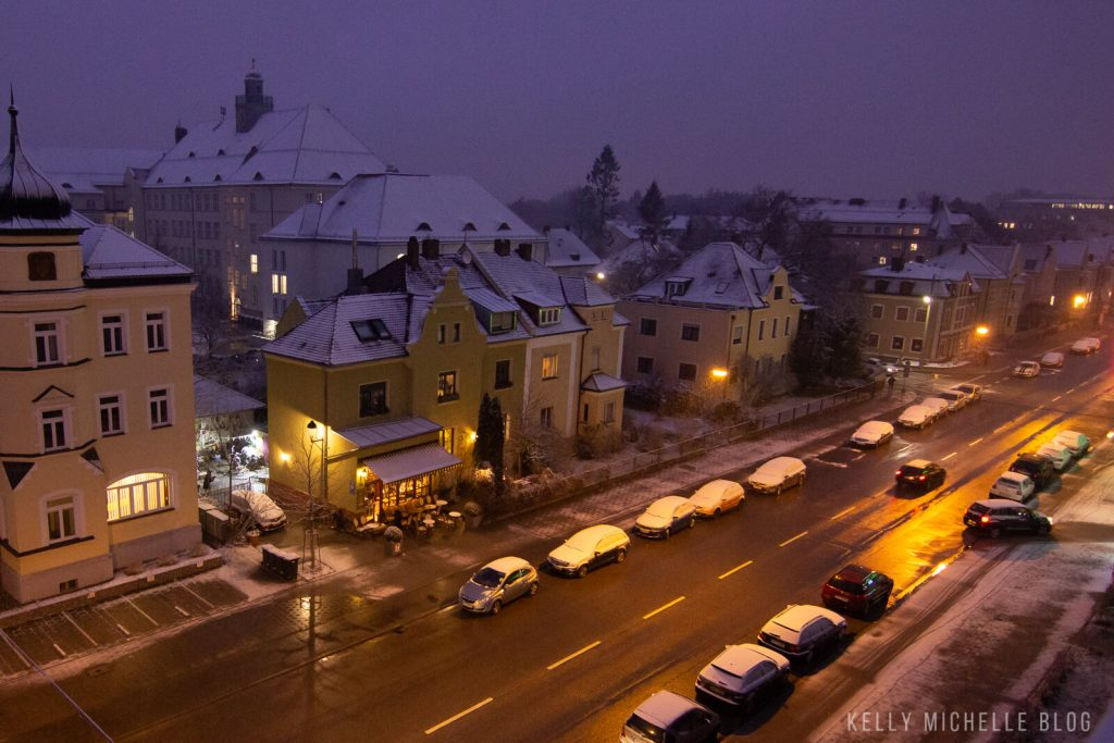 Early morning picture of a street in Germany with buildings covered with snow.